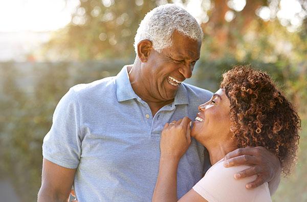 59_Brochure_0001_portrait-of-smiling-senior-african-american-couple-53JSG9Y